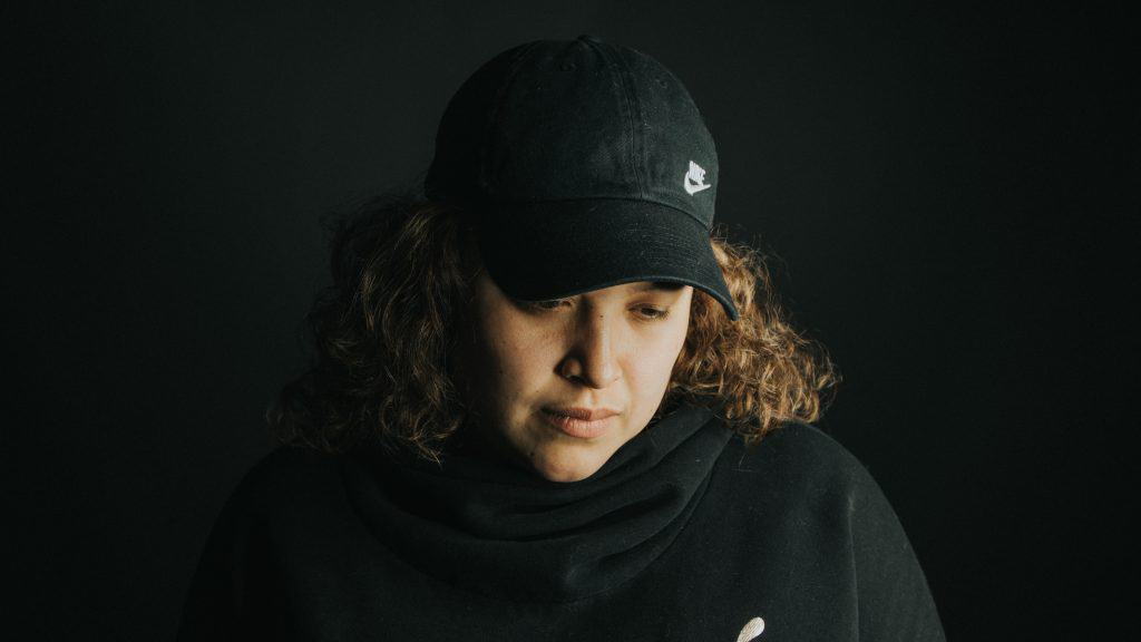 woman in black jacket and cap