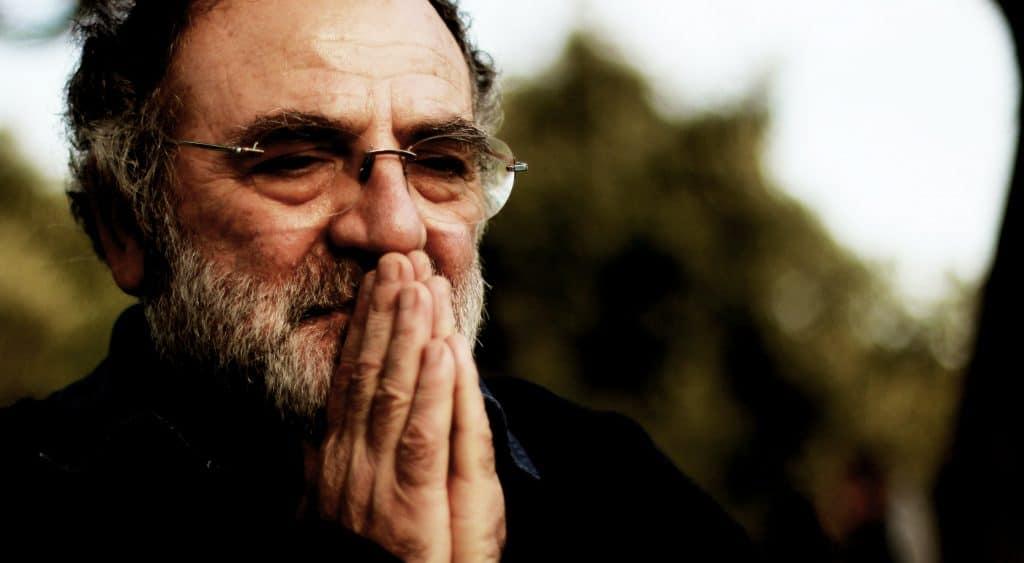 praying man wearing eyeglasses