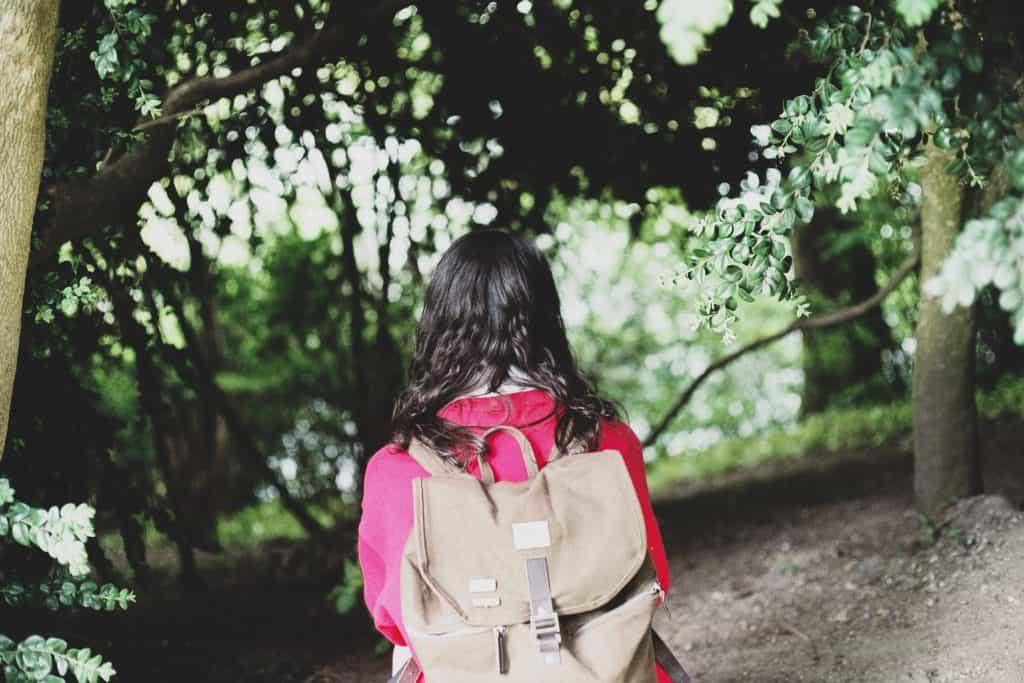 woman wearing brown backpack