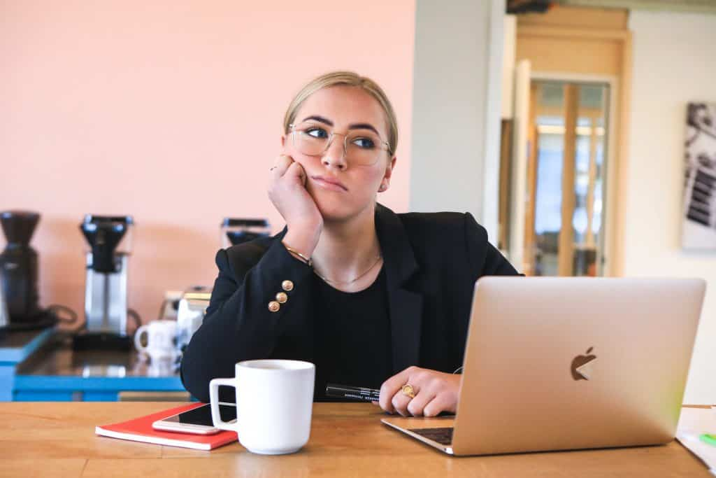 woman in black long sleeve shirt using macbook